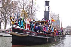 Sinterklaas Intocht In mid November, the Dutch Santa Claus arrives from Spain with his staff and Black Pete helpers at a different port each year.