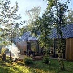 Heavy thunder and rainfall appeared just before dinner and almost killed the fire. Luckily it disappeared just as quickly as it had arrived. Cabins In The Woods, House In The Woods, Building A Cabin, Forest House, Modern Barn, Cabins And Cottages, Future House, House Design, House Styles