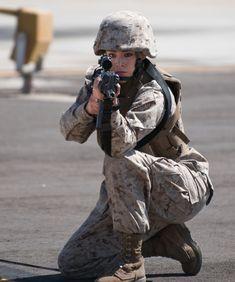 Female Marine? No, just a Marine who happens to be female. Semper Fi.