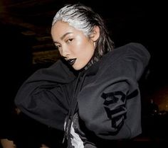 Bad Gal Gothic - There's a subversive spirit in the air, from the slicked hair and obsidian lips at Rihanna's Fenty x Puma show to K-pop star CL's deep burgundy mouth and gray ombré lengths in Alexander Wang's front row.
