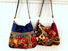 Pretty plush vintage velvet purse. Plush Boho bag in browns, golds, purples and pinks. Really really pretty. Handles with brass rings. Inside floral lining with magnetic closure and a zipper pocket. Contrasting back with floralvelvet pocket. Measures 16 X 12