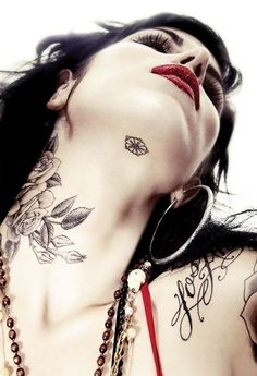 The beautiful Kat Von D is sporting a floral pentagon under her chin.
