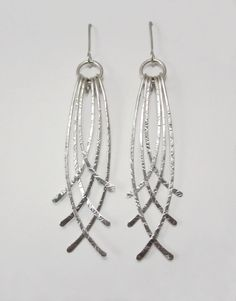 Sterling silver crossed hammered wire earrings by GenevieveJuillet, $80.00