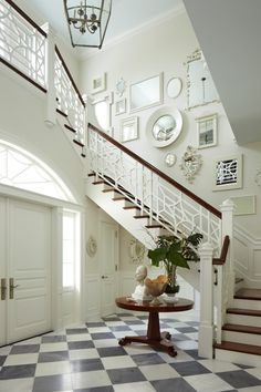 Black and white floor tiles, Chippendale stair rail and placement of art on walls