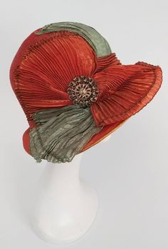View this item and discover similar for sale at - Burnt Orange & Seafoam Green Wide Brim Cloche Hat. Pleated fabric drapes across the front of this hat, furthered embellished with art nouveau pin Elsa Schiaparelli, Vintage Outfits, Vintage Fashion, Vintage Hats, Victorian Fashion, Art Nouveau, 1920s Hats, Flapper Hat, 1920s Flapper