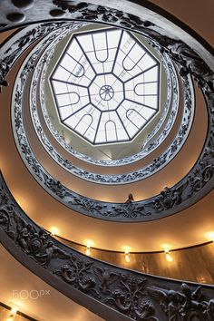 Round and round... - This is the well known stairway of Vatican museum, a perfect structure with shapes and figures that trap the eye.  Plus, the leading to the light which is symbolic...