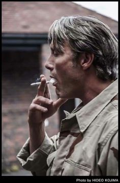 """baba-yaga-not-only: """"He is by himself, smoking a cigarette outside while waiting. He looks so cool and I'm just watching him, and then like 5 minutes have gone by…"""" - Hideo Kojima on Mads Mikkelsen Mads Mikkelsen, Beautiful Men, Beautiful People, Hannibal Funny, Hannibal Lecter, Hugh Dancy, Celebs, Celebrities, Bad Boys"""