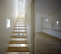 Small House with big Spiral Staircase by Hideshi Abe - slab stairs.
