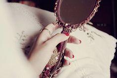 belle holding mirror