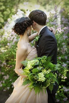 rustic brown and green wedding bouquet with ferns, pods and fern curls | photo: Studio 306 Photography- love the champagne colored dress