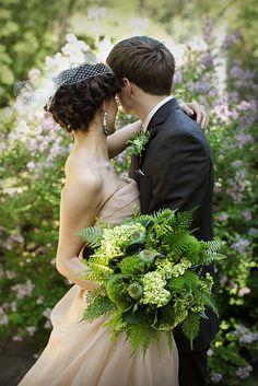 emerald fern and poppy sead head bouquet