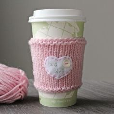 Quick and easy knitted cup cozy adds some style to your coffee cups.  Full tutorial too! Embroider something special for your loved one!