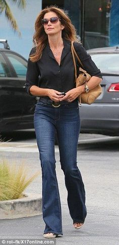 Lovely as ever: The 49-year-old displayed a certain fountain of youth as well behind her tinted shades
