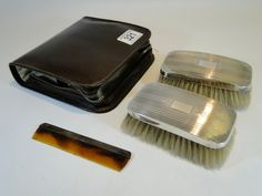 321) Gentleman's art-deco leather cased engine turned silver travelling double brush and comb set – uninscribed – Birmingham 1935 Jubilee mark Est. £25-£35