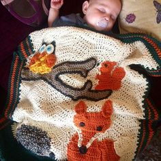 Just look at this gorgeous boy snuggled under his woodland blanket.  There is…