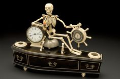 Alarm clock, mounted on model of coffin, probably English, 1840-1900  source: Science Museum, London