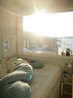 perfect tiny bedroom: a view, white, comfy bedding, coffee, sunlight.  love (via http://scandinavianretreat.blogspot.com)