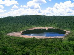 Discover Tswaing Meteorite Crater in Soshanguve, South Africa: An ancient impact crater on the outskirts of Pretoria. Small Lake, World Geography, Pretoria, North Africa, Natural Wonders, Continents, Geology, Live, Places To See