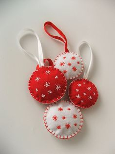 Cute little made-to-order handmade Christmas ornaments. Nice touch to add one to gift wrap with the ribbon.