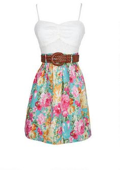 Sleeveless twofer dress with crochet bodice and floral print skirt. Adjustable/removable belt at waist and invisible zipper on back for better fit.