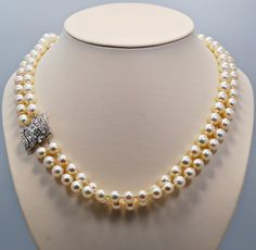 1930s double strand of the exceptional cultured pearls are 8-8.5mm in size. It is connected with a decorative