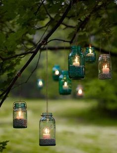 Outdoor lighting - hanging mason jars with candles and sand. I love the idea of using mason jars as decoration. Hanging Mason Jars, Mason Jar Lighting, Mason Jar Lamp, Hanging Candles, Hanging Lights, Floating Candles, Diy Hanging, String Lights, Floating Lights