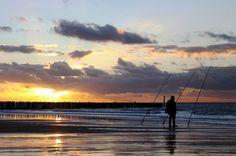 Fisherman on the beach in Cadzand-bad at sundown