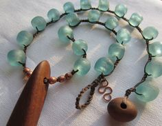 Ecofriendly Crochet Necklace - Bead Crochet Jewelry - Recycled timber pendant, African recycled glass beads. $135.00, via Etsy.