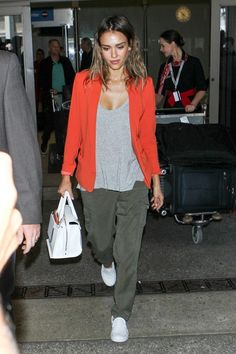 Jessica Alba wearing Vans Classic Slip Ons in True White, Reese + Riley Drew Blazer and Sanctuary Soft City Pants.