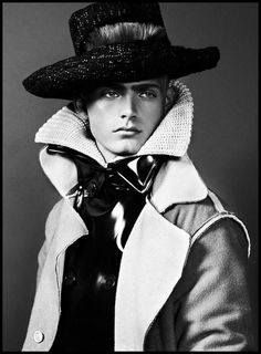 Black and White handsome Men's Fall Editorial with coat, sweater and hat.
