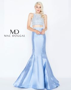 Check out this sexy two-piece! The top is adorned with a classy crystal pattern while the mermaid skirt is simple and silky. In Store: Periwinkle Blue. www.thepradocollection.com #prom   #promdress   #2018