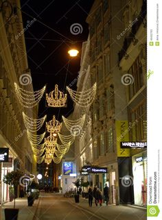 Electric crowns garlands decoration as Christmas decoration on shopping street in Vienna at night.