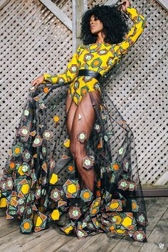 The ESTHER African print skirt. Full tulle circle skirt with hand sewn african print fabric cut outs     Paired with a african print body suit sold separately. (affiliate)