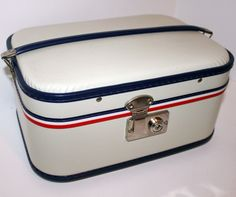 How cute is this one with its Red, white, and Blue!   Vintage Train Case Make Up Cosmetics Suitcase Toiletries. $38.00, via Etsy.