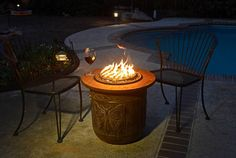Outdoor propane fire pits sold at patio furniture stores can be expensive, and wood-burning ones are bad for our air quality. But if you're handy with a few simple tools, you can build a cleaner-burning propane fire pit for a lot less money in a snap. Portable Propane Fire Pit, Diy Gas Fire Pit, Outdoor Propane Fire Pit, Small Fire Pit, Metal Fire Pit, Modern Fire Pit, Fire Pit Backyard, Fire Fire, Fire Pit Chairs