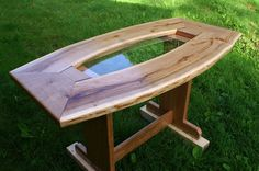 Vermont Curved Cherry Slab Dining Table with Glass Center and Trestle Base On Sale by VermontWoodCreations on Etsy https://www.etsy.com/listing/118404884/vermont-curved-cherry-slab-dining-table