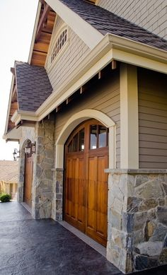Love the garage doors and the stone. | Home Ideas Worth Pinning