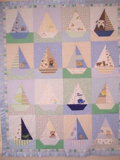 sailboats made from old baby clothes--what a great memory quilt! Quilt Baby, Baby Memory Quilt, Lap Quilts, Memory Quilts, Used Baby Clothes, Baby Clothes Quilt, Coastal Quilts, Keepsake Quilting, Colorful Quilts