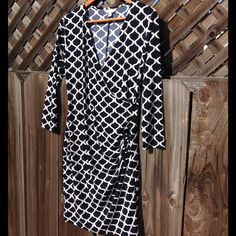 Wrap Dress This Midnight Blue illusion wrap dress is perfect for work to weekend! You'll be comfy & stylish in this touch of spandex/polyester blend dress.  Never been worn. Charming Charlie Dresses