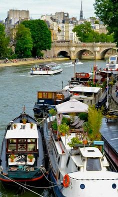 Houseboats along the Seine in Paris. What a beautiful city and what a wonderful place and way to live. www.thepresentationpros.com