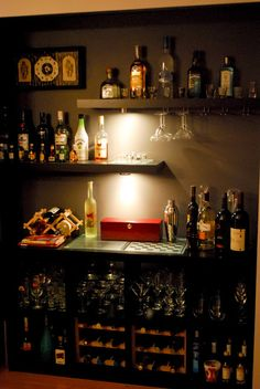 Materials: 4x4 Expedit, Lack shelves, Hutten, Counter lamps, wine glass holdersDescription: Not the first Expedit bar hack, but hopefully you all will still app