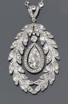 A belle époque diamond pendant-enhancer and diamond necklace.