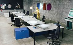 Office & Workspace:Brilliant Workspace Studio Companies Design By Henrique Steyer With Wall Lighting On Play Ornament With White Work Desk Table And Black Swivel Arm Chairs On Light Brown Ceramic Floor Tiles And Video Games Virtuosity Henrique Steyer: Fantastic Contemporary Workspace designs