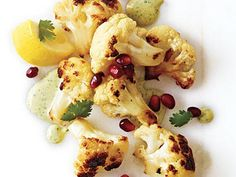 Fried Cauliflower with Tahini and Pomegranate Seeds | Cilantro gives this a bright, zippy taste and lovely color; the leaves are especially festive when strewn with pomegranate arils over the cauliflower. Serve with hot sauce and cut lemons, if you wish.