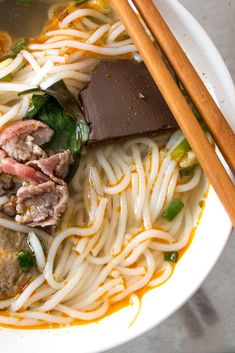 Find out why the spicy noodle soup known as Bun Bo Hue is a must eat in Hue, Vietnam.