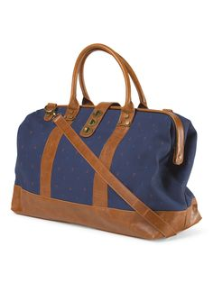 This navy blue duffle bag with small anchors on it would be perfect for traveling some place nautical!