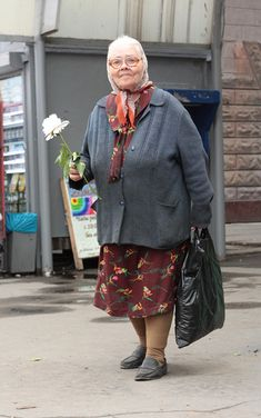 What a wonderful expression on this old woman's face. From the Hipsters from Omsk photo series on englishrussia.com.