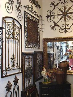 Love using iron with Tuscan Decor. A little much here. but love the different styles.
