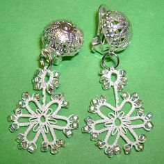 Silver filigree clip on snowflakes by yarnplayer, via Flickr