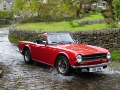 Triumph TR6.  A colleague had one way back and fitted nitrous - went like stink ... in a straight line.  Nitrous was not good for cornering!